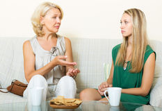 Serious mother and daughter talking Stock Image
