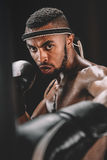 Serious muay thai fighter training isolated on black royalty free stock photography