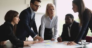 Free Serious Multiracial Team With Female Manager Brainstorming On Paperwork Stock Photo - 161285270