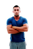 Serious muscular man with arms folded Stock Images