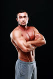 Serious muscular man with arms folded Royalty Free Stock Images