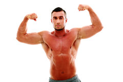 Serious muscular man showing his biceps Royalty Free Stock Photography