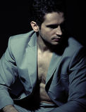 Serious muscular man wearing suit Royalty Free Stock Image