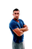 Serious muscular sportsman with arms folded Royalty Free Stock Image