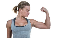 Serious muscular woman flexing muscle Stock Image