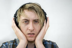 Serious Music Listener Stock Photography
