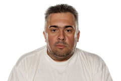 Serious obese man. Portrait of a serious obese man Royalty Free Stock Photography