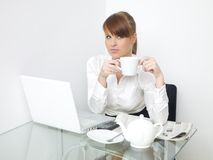 Serious Office Woman Having Coffee While Working Royalty Free Stock Photo