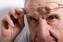 Serious old man Stock Images