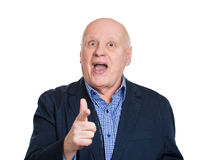 Serious old man pointing Stock Images