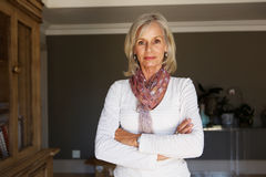 Free Serious Older Woman Standing In Study With Arms Crossed Stock Photo - 88692910