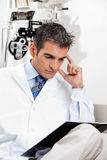 Serious Optometrist At Work Royalty Free Stock Photo
