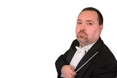 Serious Orchestra Conductor. A serious looking orchestra conductor scowls at the camera, isolated against a white background Stock Photos