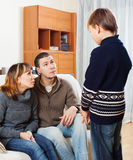 Serious parents scolding  son Royalty Free Stock Photography