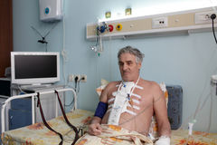 Serious patient in a hospital ward royalty free stock photography