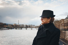 Serious Pensive Bearded Man Wearing Hat in Paris. France, Walking near Seine River. Headshot Composition, Space for Text Royalty Free Stock Photography