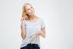 Serious pensive young girl making notes in the notebook Royalty Free Stock Images