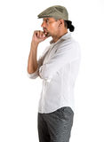 Serious pensive young man standing in profile Royalty Free Stock Photography