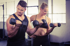 Serious people lifting dumbbell Stock Photos
