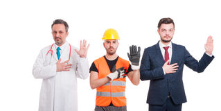 Serious people taking a vow or swearing Royalty Free Stock Photo