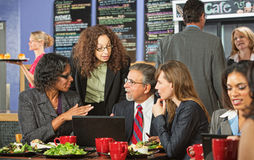 Serious People Talking in Cafe Stock Photo