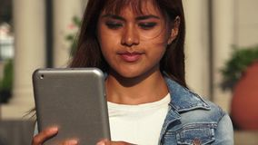Serious Peruvian woman with tablet. A pretty young Peruvian adult female stock footage