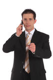Serious phone call Royalty Free Stock Photos