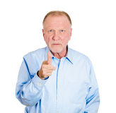 Serious pointing older man Royalty Free Stock Images