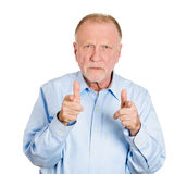 Serious pointing older man Royalty Free Stock Photo