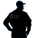 Serious policeman with looking to his side stock image