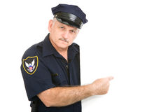 Serious Policeman Pointing royalty free stock photo