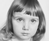 A serious portrait of a cute baby girl in black and white Royalty Free Stock Photo