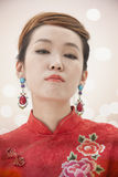 Serious and Pouty Young Woman with Qipao, Looking At Camera Royalty Free Stock Photography