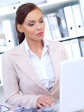 Serious Pretty Businesswoman Using Laptop Stock Photos