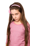 Serious pretty girl at age eleven on white Royalty Free Stock Photography