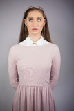 Serious pretty model with pink dress on looking up Stock Images