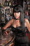 Serious Pretty Woman at Bar Royalty Free Stock Photos