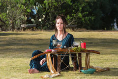 Serious Priestess with Pagan Altar Stock Photography