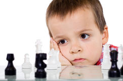 Serious problem solving concept. Boy playing chess - serious problem solving concept - isolated Stock Photos