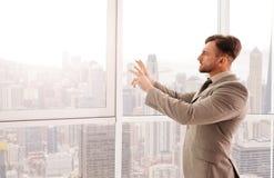 Serious professional businessman using new technologies Stock Photos