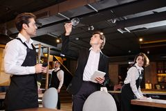 Professional restaurateur checking wineglass royalty free stock photography