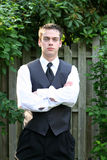 Serious Prom Boy With Arms Folded Royalty Free Stock Image