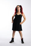 Serious Punk Girl in Combat Boots and Black Dress Stock Images