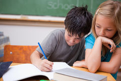 Serious pupils working together Stock Photography