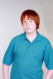 Serious Red Haired Boy Stock Images