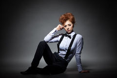 Serious red-haired woman posing in office suit Royalty Free Stock Image