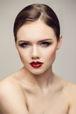 Serious red lips girl Stock Image