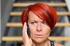 Serious Redhead Woman Calling Someone on Phone Royalty Free Stock Photos