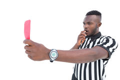 Serious referee showing red card blowing whistle Royalty Free Stock Images