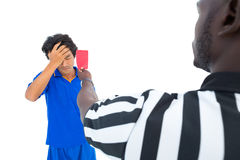 Serious referee showing red card to player Stock Photography
